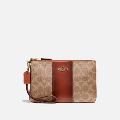 Muñequera-Signature-de-Coated-Canvas---Coach