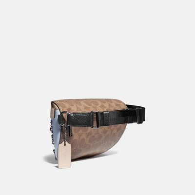 Bolsa-Cruzada-tipo-cangurera-con-Pines---Coach