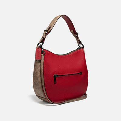 Bolsa-de-hombro-Sutton-en-Coated-Canvas---Coach