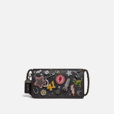 Bolsa-cruzada-Dinky-con-cadena-1941-Coach-Create-Souvenirs-Pins-Coach