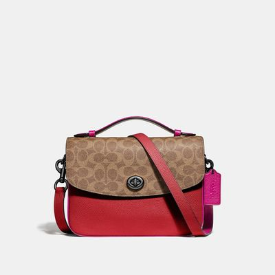 Bolsa-cruzada-Cassie-de-Coated-Canvas-Coach
