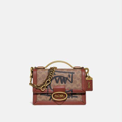 Bolsa-cruzada-Riley-Top-Handle-22-1941-Rexy-By-Guang-Yu-de-Coated-Canvas-Coach