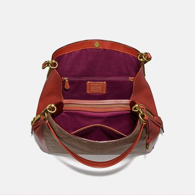 Bolsa-de-Hombro-Dalton-31-en-Coated-Canvas-Coach