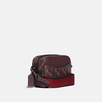 Bolsa-cruzada-camera-bag-Horse-and-Carriage-en-Coated-Canvas-y-estampado-Coach