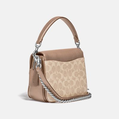 Bolsa-cruzada-Cassie-19-de-Coated-Canvas-Coach