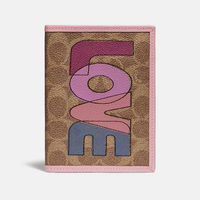 Porta-pasaporte-Love-en-Coated-Canvas-Coach