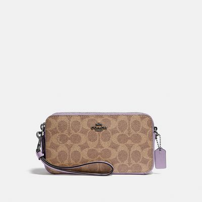 Bolsa-Cruzada-Kira-en-Coated-Canvas-Coach