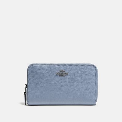 Cartera-mediana-Medium-Zip-Apround-en-Cuero-Coach
