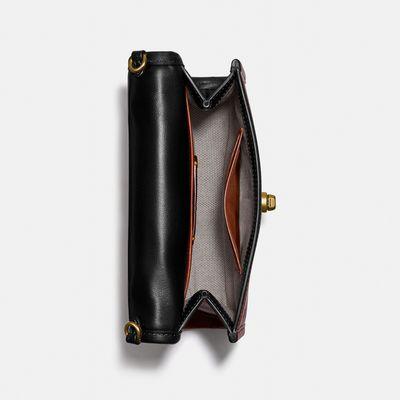 Bolsa-Cruzada-Kip-Turnlock-Coach
